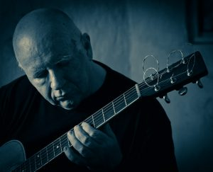 Michael Smith: blue guitar, Photo by Kevin Viol.